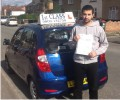 Emre with Driving test pass certificate