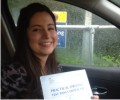 Marcela with Driving test pass certificate