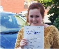 Simone with Driving test pass certificate