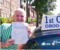Billy with Driving test pass certificate