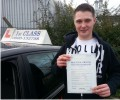 John with Driving test pass certificate