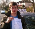 George with Driving test pass certificate