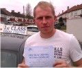 Joe with Driving test pass certificate