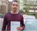 Lawrence with Driving test pass certificate