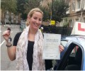 Sarah with Driving test pass certificate