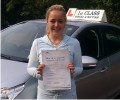 Demi with Driving test pass certificate
