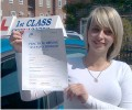 Tasha with Driving test pass certificate