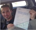 Shkelzen with Driving test pass certificate
