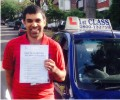 Adrian with Driving test pass certificate