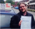 Anthony with Driving test pass certificate