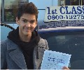 Taran with Driving test pass certificate