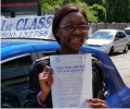 Ruth with Driving test pass certificate