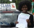 Rosa with Driving test pass certificate