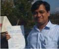 Sameer with Driving test pass certificate