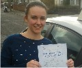 Emma with Driving test pass certificate