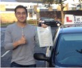 Cheuk with Driving test pass certificate