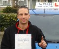 Russell with Driving test pass certificate